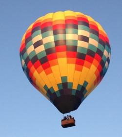 balloon deflation economic metaphor
