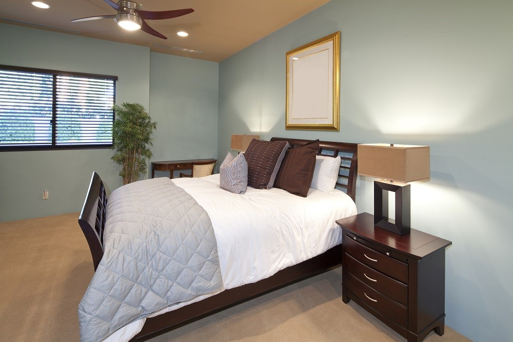 Basic Bedroom With Cyan Color Walls Propertylogy
