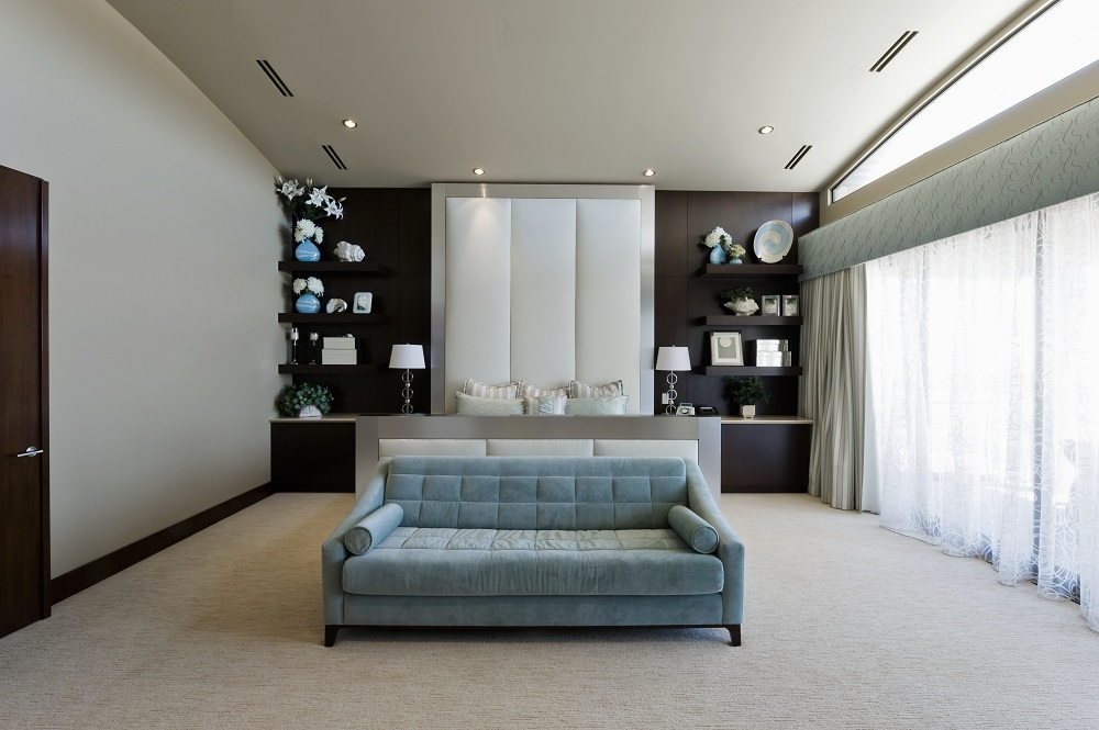 Pastal symmetry living room with sofa as center piece for Difference between living room and family room